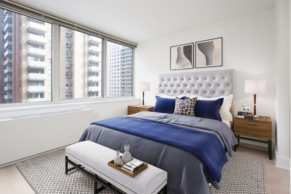 Cozy bedroom with large windows and an amazing view of the city at The Ventura in New York, New York