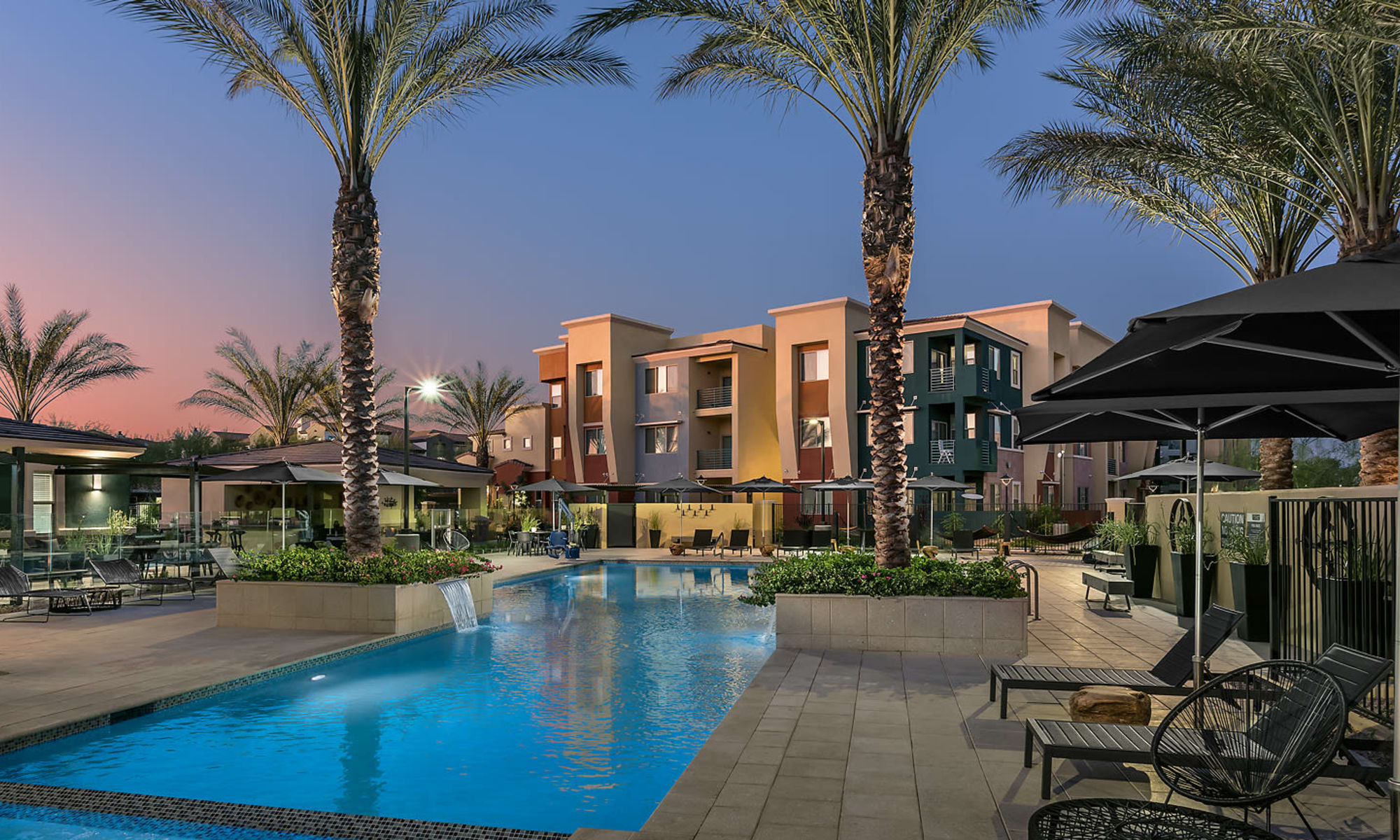 Apartments with a resort style community swimming pool at Villa Vita Apartments in Peoria, Arizona