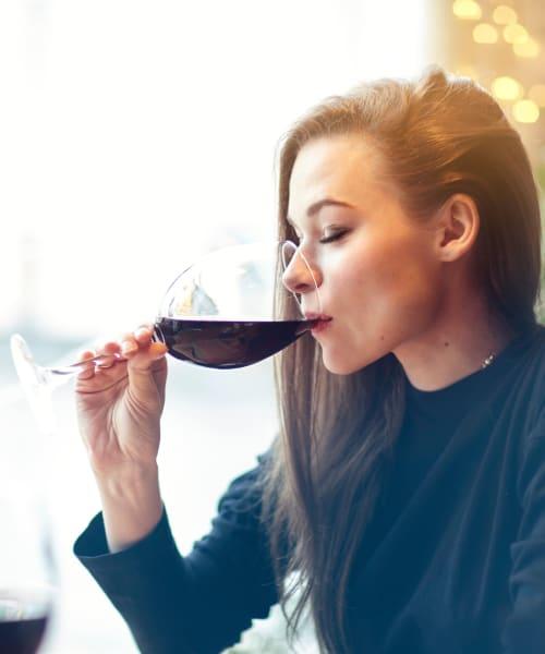Resident drinking wine at a bar near Harrison Tower in Portland, Oregon