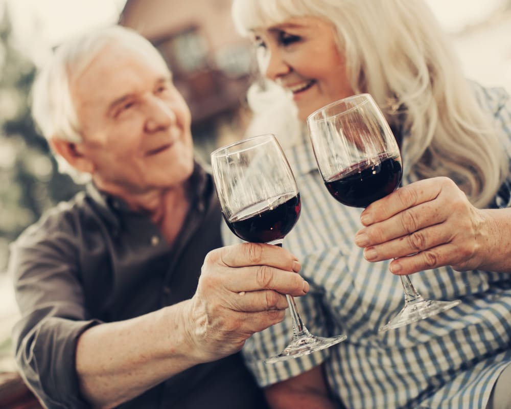 Resident enjoying some wine at WellQuest of Granite Bay in Granite Bay, California