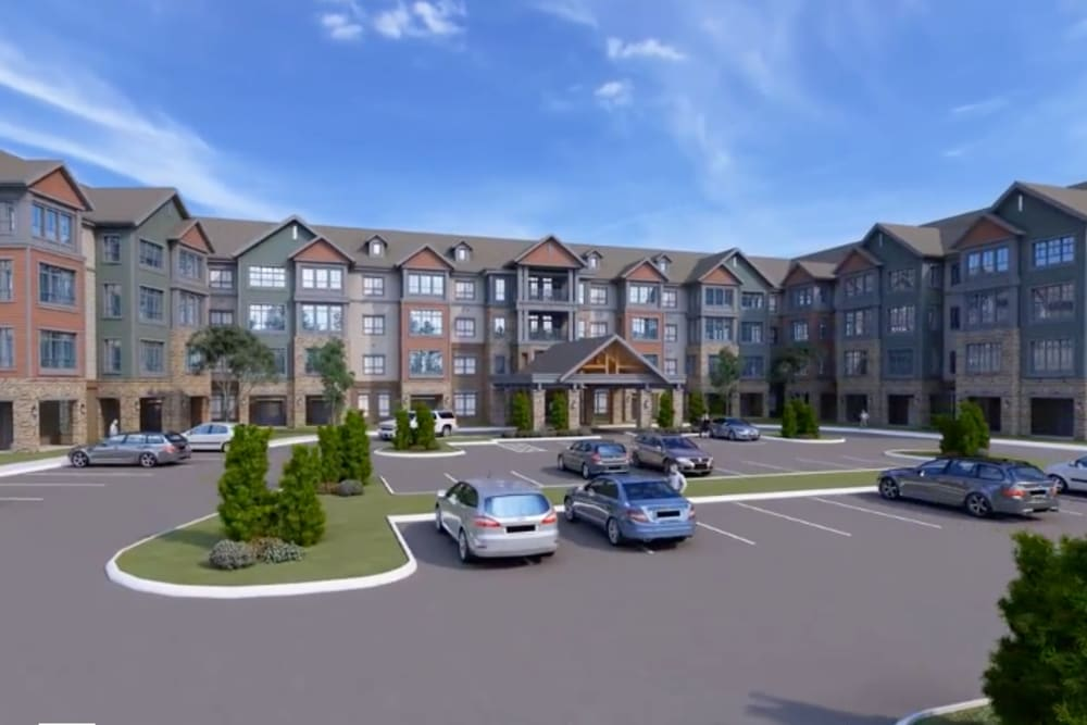 A rendering of the parking lot and building exterior at Harmony at Greensboro in Greensboro, North Carolina