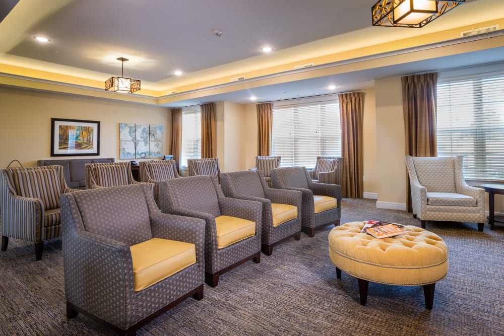 Comfortable seating in Memory Care at Harmony at Five Forks in Simpsonville, South Carolina