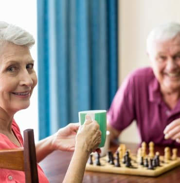 Residents playing chess at Evergreen Court in North Bend, OR