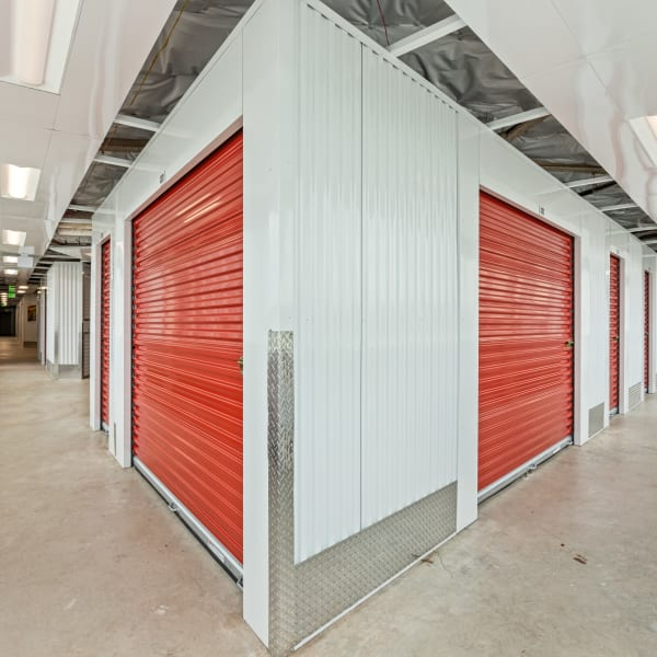 Indoor storage units with red doors at StorQuest Express - Self Service Storage in Gilbert, Arizona