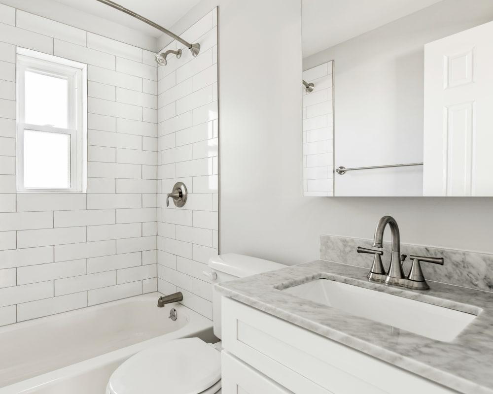 Clean bathroom at Eagle Rock Apartments at Huntington Station in Huntington Station, New York