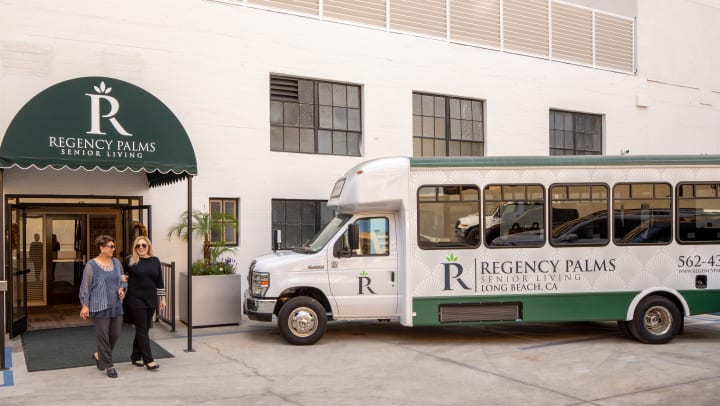 Exterior image of Regency Palms Long Beach with bus parked outside