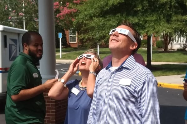 Team members checking out the solar eclipse at Discovery Senior Living in Bonita Springs, Florida
