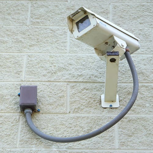 Security camera mounted on an exterior wall at Red Dot Storage in Yorkville, Illinois