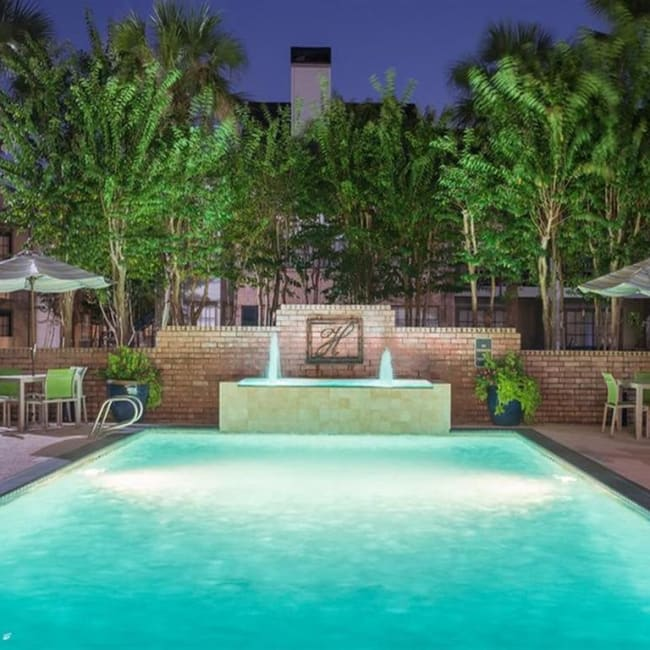 Beautifully lit swimming pool at night at McAlister in Webster, Texas