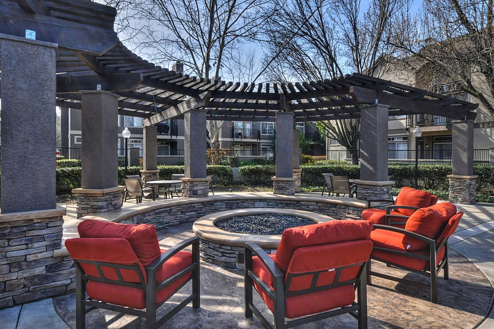 A clubhouse patio next to a large firepit at Larkspur Woods in Sacramento, California