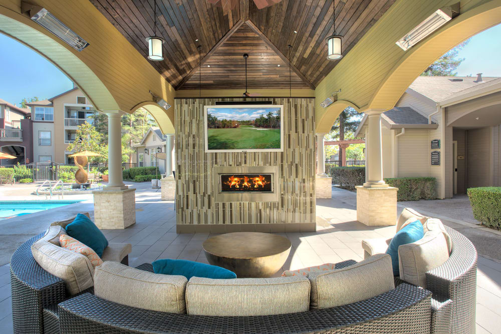 Outdoor lounge area with a flat-screen TV at Rosewalk in San Jose, California