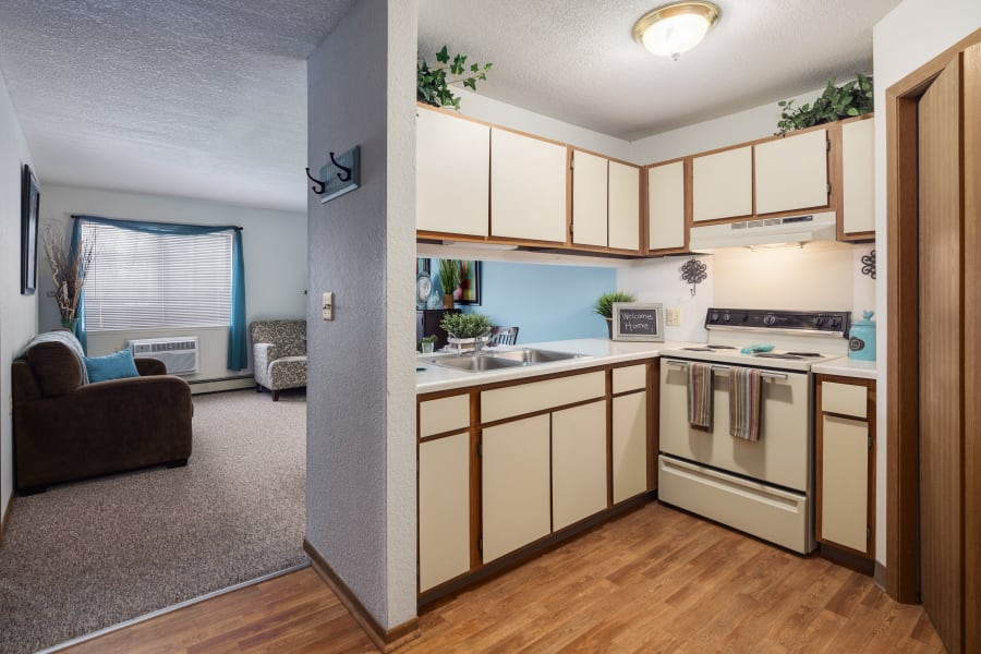An kitchen and living room at Parkside of Livonia in Livonia, Michigan