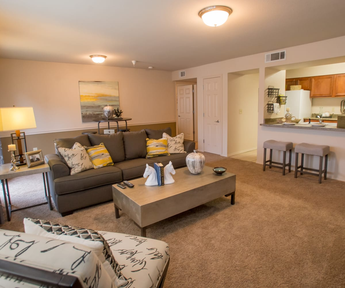 Bright living room at Villas of Waterford Apartments in Wichita, Kansas