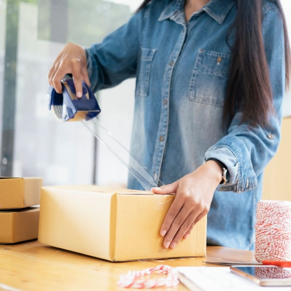 A woman uses packing supplies available at Big E Self Storage in Stockton, California