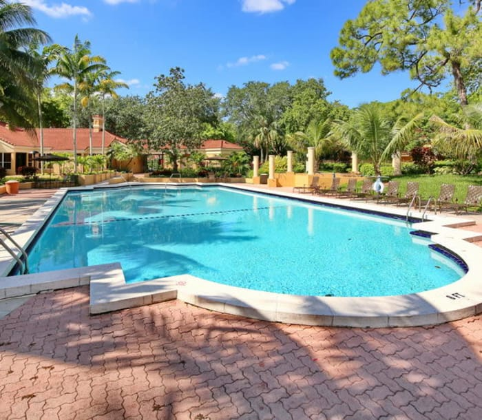 Swimming pool area at IMT Pinebrook Pointe in Margate, FL