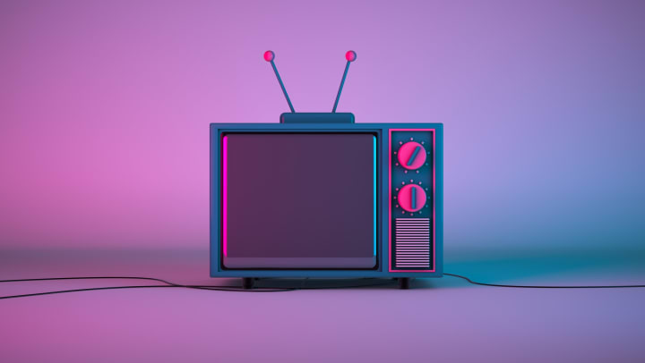 Old-school TV with pink/blue lighting