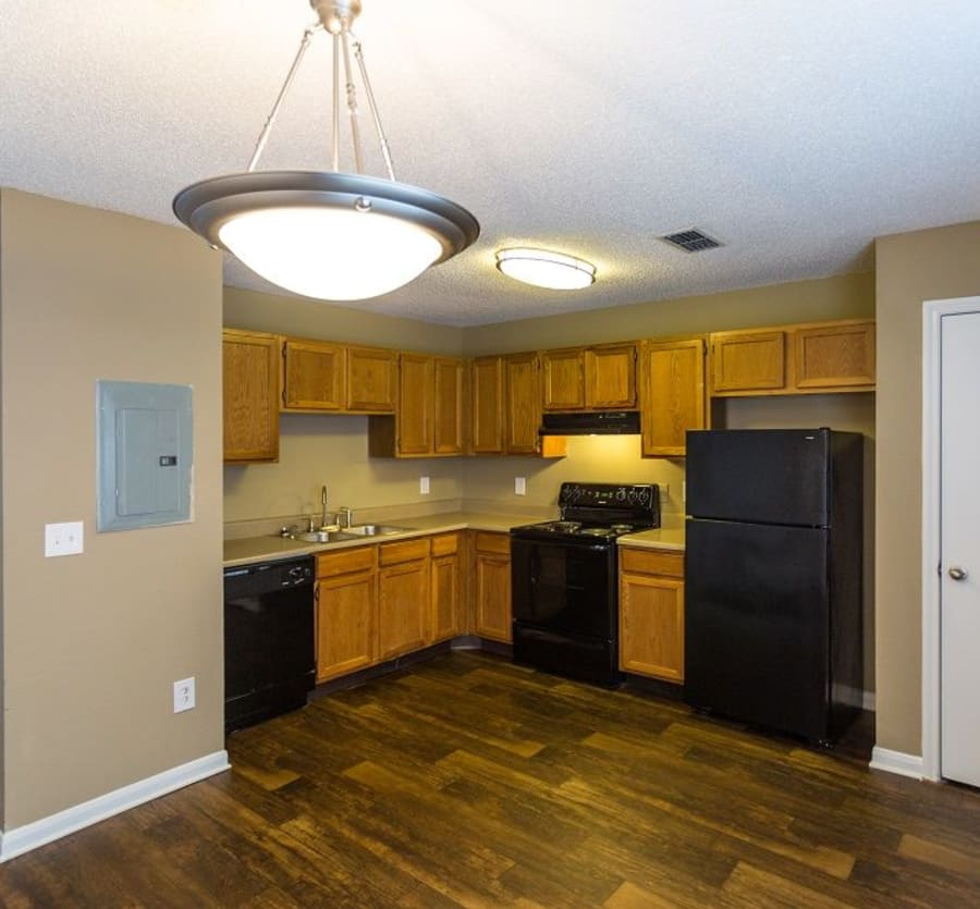 Kitchen with black appliances at Cypress Creek Townhomes in Goodlettsville, Tennessee