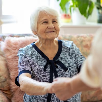 Laughing resident at RockBrook Memory Care in Lewisville, Texas