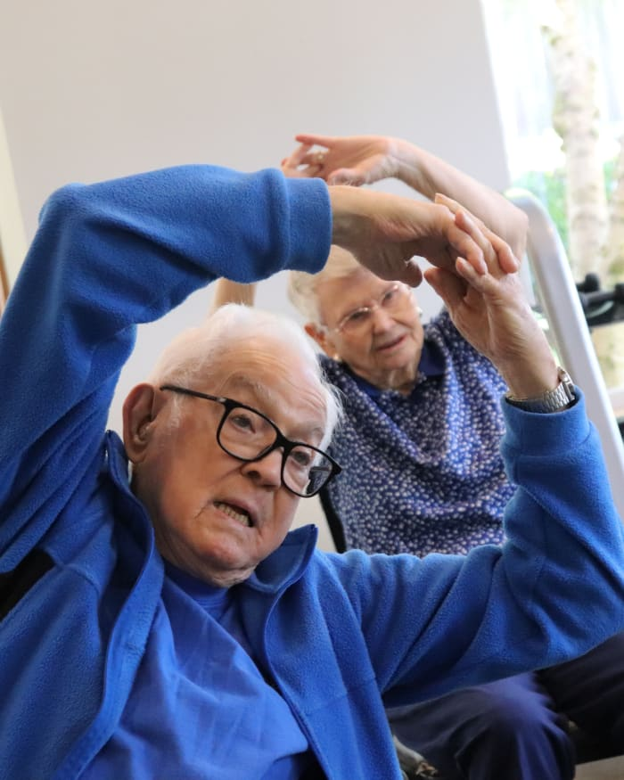 Resident working out in exercise class at The Springs at Clackamas Woods in Milwaukie, Oregon
