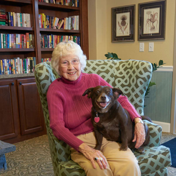 Senior lady sitting with her dog