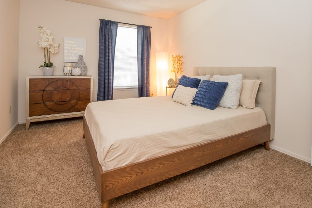 Spacious bedroom at Raintree Apartments in Wichita, Kansas