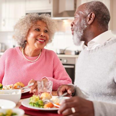 Resident couple enjoying a meal together at Ebenezer Ridges Campus in Burnsville, Minnesota