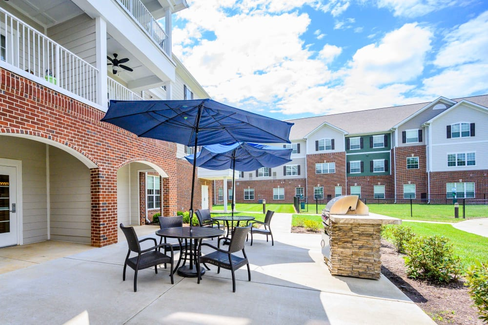 Outdoor patio with grill at Harmony at Victory Station in Murfreesboro, Tennessee