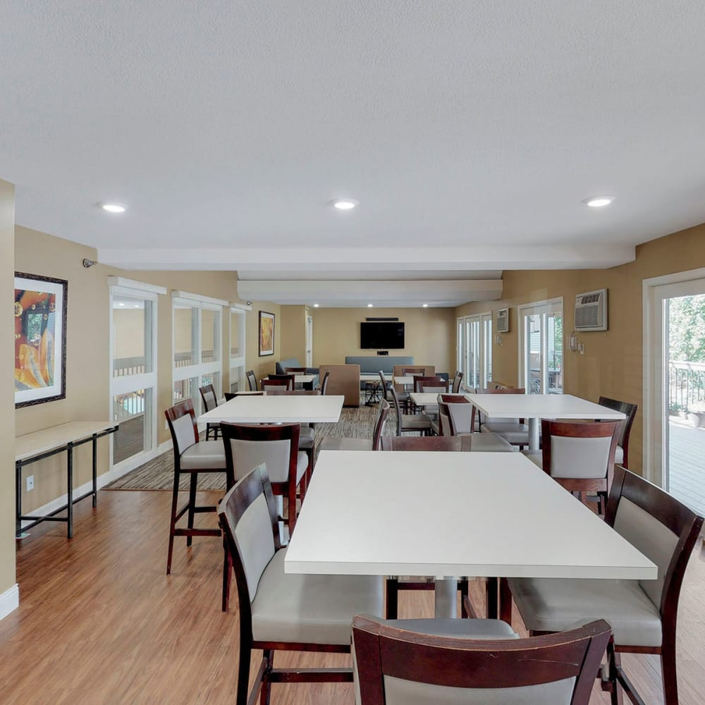 Spacious club room with ample gathering areas in the resident clubhouse at Oaks Vernon in Edina, Minnesota