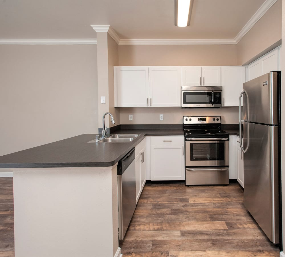 Kitchen with stainless-steel appliances at The Vintage at South Meadows Condominium Rentals in Reno, Nevada