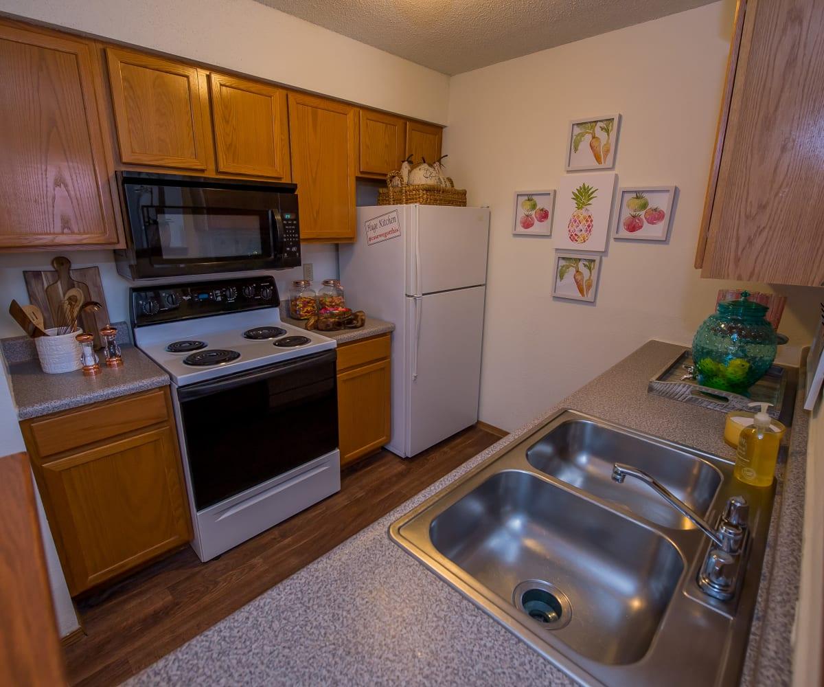 Fully equipped kitchen at Huntington Park Apartments in Wichita, Kansas