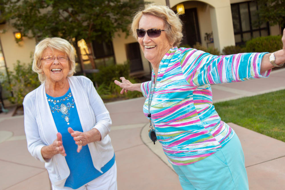 Ladies dancing together at Merrill Gardens at Campbell  in Campbell, CA