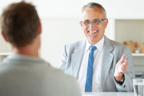 A services representative discussing terms with a client