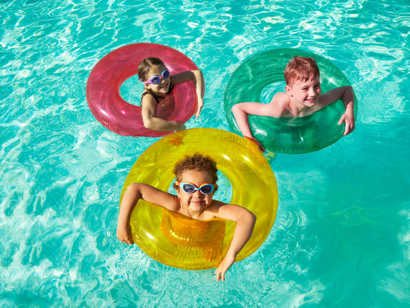 Kids playing in pool at Las Casas at Windrose in Litchfield Park, Arizona