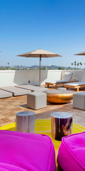 Roof top lounge for sunbathing at Brio Apartment Homes in Glendale, California