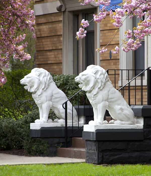 Lion statues placed at front door of an apartment at Clemens Place in Hartford, Connecticut