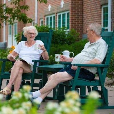 Residents sitting outside near Ebenezer Ridges Campus in Burnsville, Minnesota.