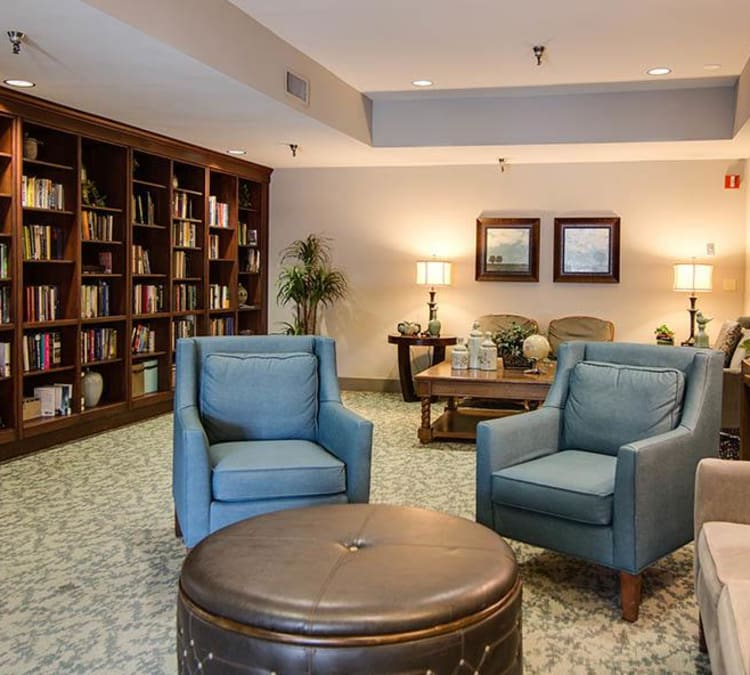 Quaint library with comfortable seating at The Commons at Woodland Hills in Woodland Hills, California