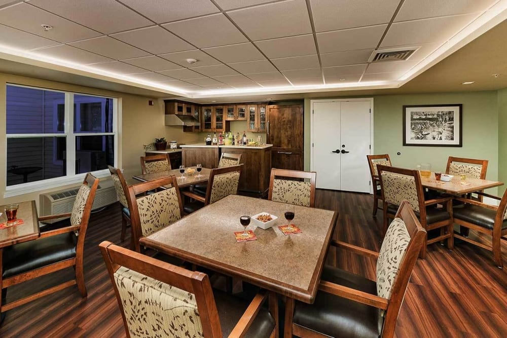 Inviting game room with wood accents atThe Springs at Grand Park in Billings, Montana