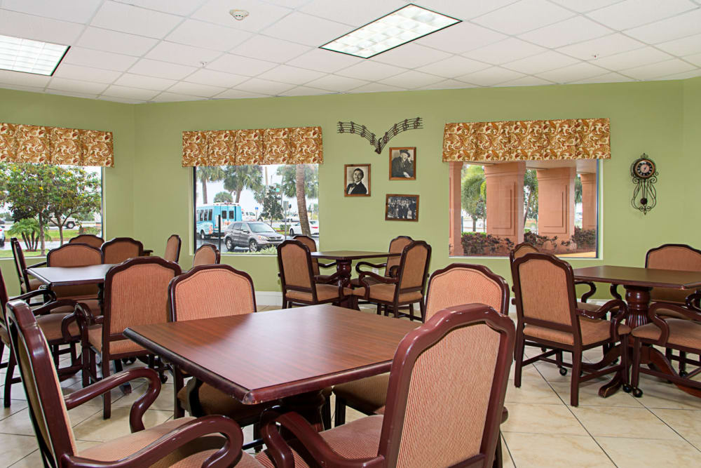 Large dining hall with tables and chairs at Grand Villa of Melbourne in Florida