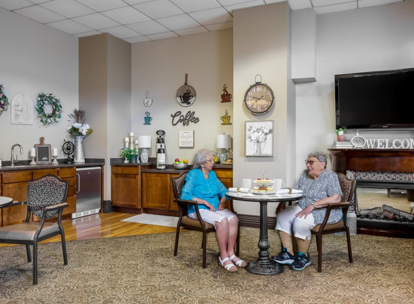 Resident enjoying a conversation at Ramsey Village Continuing Care in Des Moines, Iowa