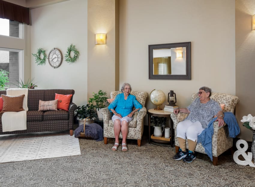 Resident enjoying the spacious common area at Ramsey Village Continuing Care in Des Moines, Iowa