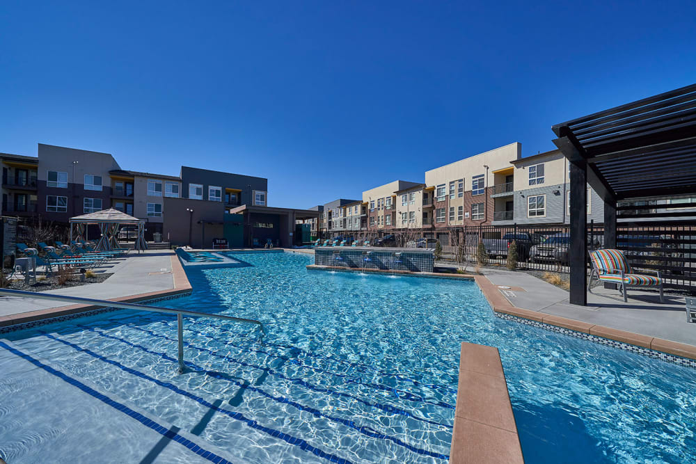 Resort-style swimming pool at Encore Evans Station in Denver, Colorado