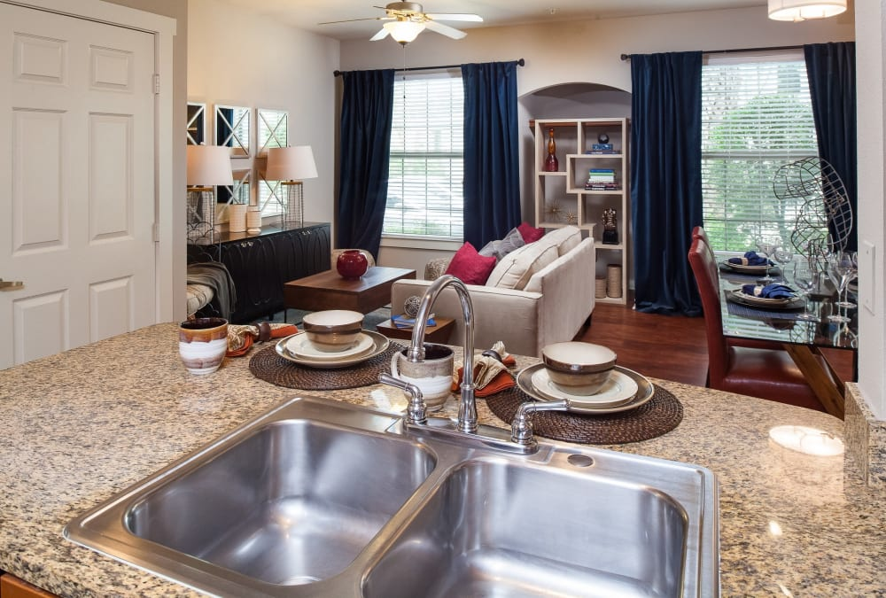 Open-concept floor plan with hardwood floors in the living area of model home at Lakefront Villas in Houston, Texas