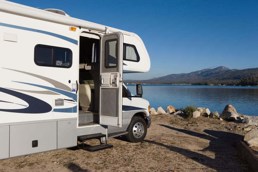 An RV parked in front of a lake near Trojan Storage in San Diego, California