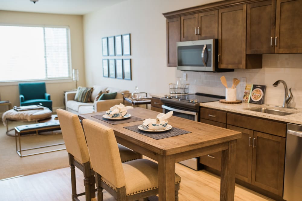 A kitchen, dining room and living room at Touchmark at Fairway Village in Vancouver, Washington
