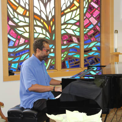 A resident playing the piano at Ebenezer Ridges Campus in Burnsville, Minnesota