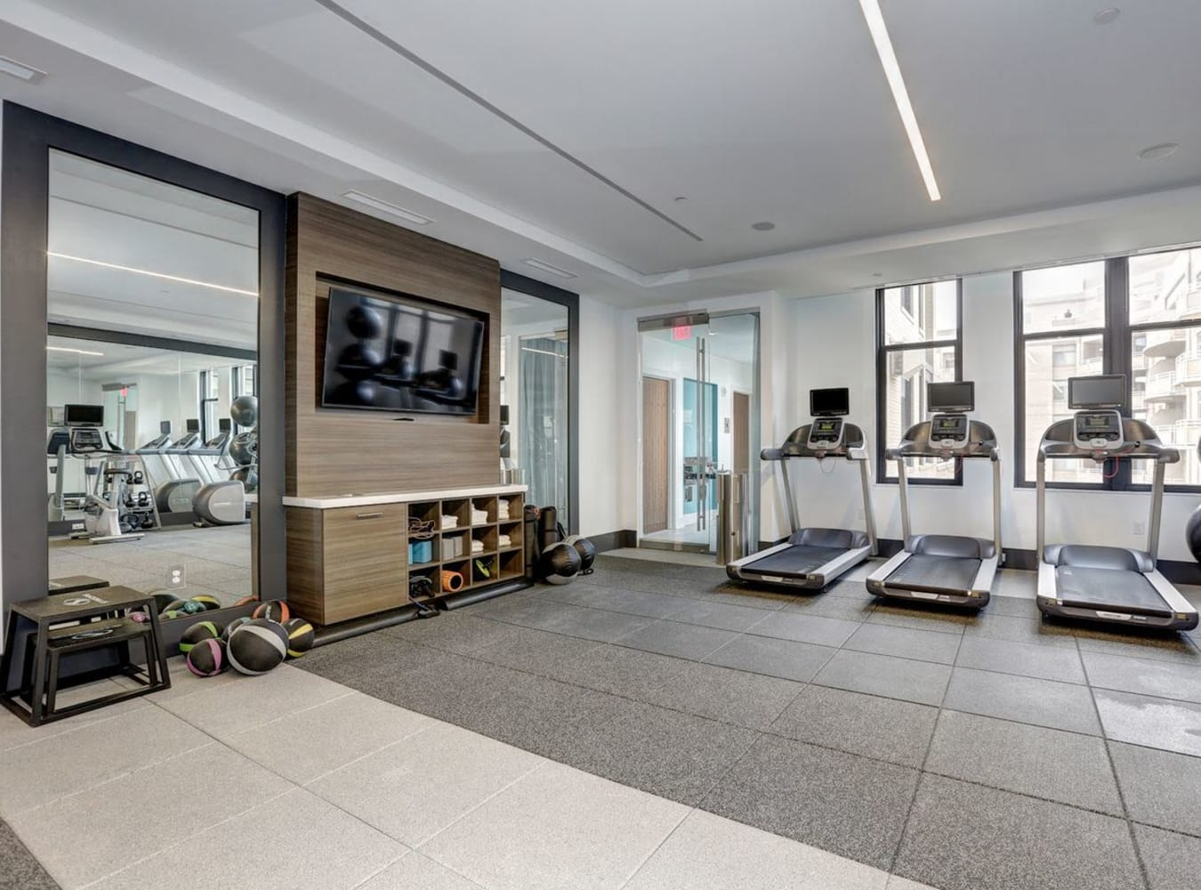 A clean and spacious fitness center at Solaire 7077 Woodmont in Bethesda, Maryland