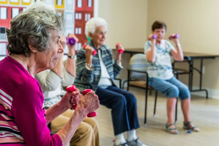 Residents exercise at Harmony at West Ashley in Charleston, South Carolina