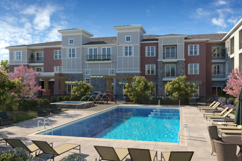 Pool & sundeck at Avenida Naperville senior living apartments in Naperville, Illinois