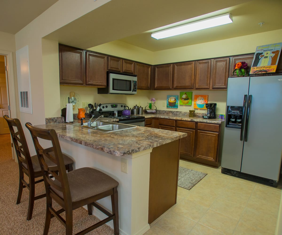 Kitchen at Coffee Creek Apartments in Owasso, Oklahoma